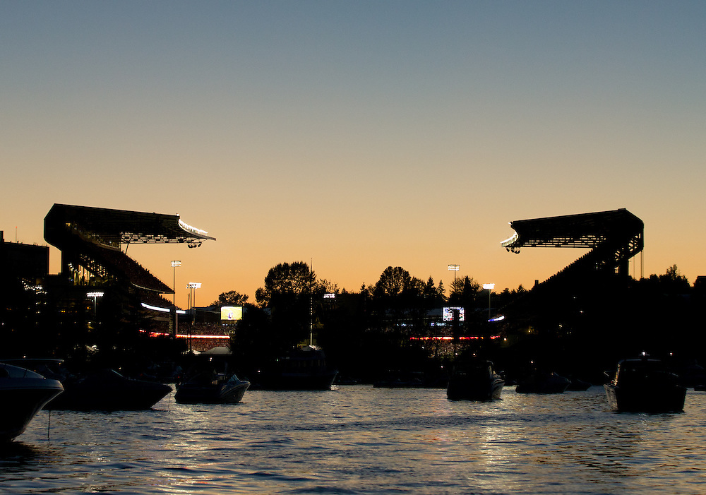 A sunset view of Husky Stadium from Union Bay during an NCAA football game between the University of Washington Huskies against Boise State Broncos at Husky Stadium on August 31, 2013 in Seattle, WA.  (Tom Hauck)