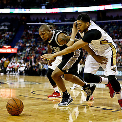Mar 3, 2016; New Orleans, LA, USA; New Orleans Pelicans forward Anthony Davis (23) and San Antonio Spurs forward David West (30) scramble for a loose ball during the second half of a game at the Smoothie King Center. The Spurs defeated the Pelicans 94-86. Mandatory Credit: Derick E. Hingle-USA TODAY Sports