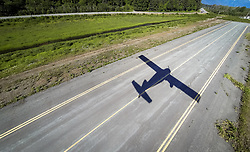 The shadow of a DeHaviland DHC-2 Beaver travels perfectly down the runway at the Haines Airport in southeast Alaska. The plane, belonging to Haines-based Mountain Flying Service was taking off for a flightseeing tour to nearby Glacier Bay National Park and Preserve.
