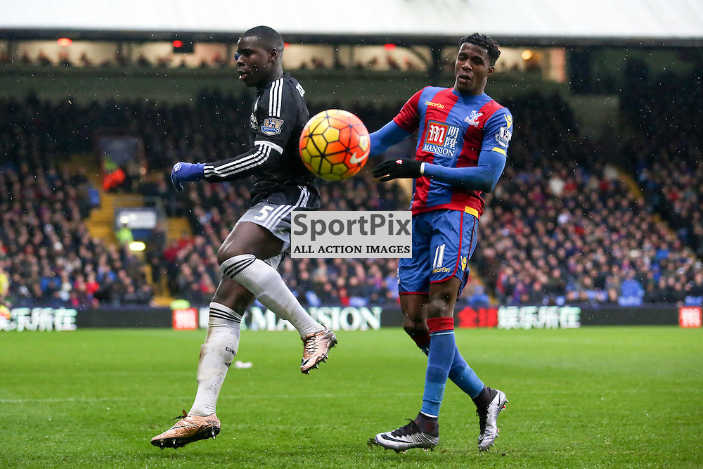 Kurt Zouma clears under pressure from Wilfried Zaha of Crystal Palace During Crystal Palace vs Chelsea Sunday 3rd January 2016