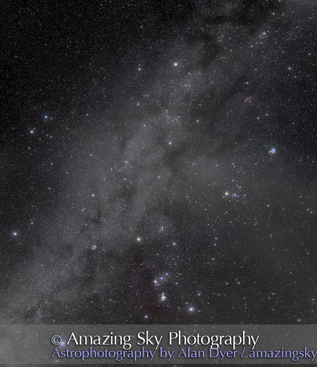 A mosaic of the northern winter Milky Way and brilliant stars and constellations in and around Orion the Hunter. The Milky Way extends here from Perseus in the north to Canis Major in the south. <br /> <br /> Throughout the scene are numerous dark lanes and dust clouds such as the Taurus Dark Clouds at upper right. The Milky Way is dotted with numerous red &ldquo;hydrogen-alpha&rdquo; regions of emission nebulosity, such as the bright Rosette Nebula at lower left and the California Nebula at upper right. The curving arc of Barnard&rsquo;s Loop surrounds the east side of Orion. <br /> <br /> Orion is below centre, with Sirius at lower left. Taurus is at upper right and Gemini at upper left. Auriga is at top and Perseus at upper right. I shot the segments for this on a very clear night on December 5, 2015 from the Quailway Cottage at Portal, Arizona. <br /> <br /> This is a mosaic of 8 segments, in two columns of 4 rows, with generous overlap. Each segment was made of 4 x 2.5-minute exposures stacked with mean combine stack mode to reduce noise, plus 2 x 2.5-minute exposures taken through the Kenko Softon filter layered in with Lighten belnd mode to add the star glows. Each segment was shot at f/2.8 with the original 35mm Canon L-series lens and the filter-modified (by Hutech) Canon 5D MkII at ISO 1600, riding on the iOptron Sky-Tracker. All stacking and stitching in Photoshop CC 2015. The soft diffusion filter helps bring out the star colors in this area of sky rich in brilliant giant stars. This version of the image has been processed to make the view better resemble what you see with the unaided eye, in a largely monochrome and softer view than the colourful and high-contrast views commonly presented in astrophotos. Even at that there is more fine structure present in the Milky Way than the unaided eye usually sees, though binoculars beging to reveal that smaller detail. I have left some colours in some stars and in the foreground of landscape scenes.