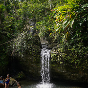 RIO GRANDE, PUERTO RICO -- FEBRUARY 1, 2019: <br /> Visitors to El Yunque National Rain Forest enjoy the waterfall and pond  at Quebrada Juan Diego (Juan Diego Creek). A few of the rain forest's popular trails and attractions are still not open to the public more that one year after Hurricane Maria's path through Puerto Rico.<br /> (Photo by Angel Valentin)