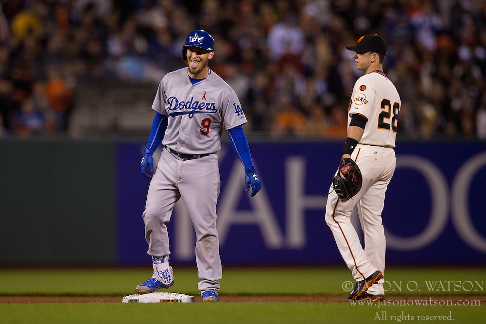 SAN FRANCISCO, CA - MAY 20:  Yasmani Grandal #9 of the Los Angeles Dodgers celebrates after hitting a double while standing on second base in front of Buster Posey #28 of the San Francisco Giants during the fifth inning at AT&T Park on May 20, 2015 in San Francisco, California.  (Photo by Jason O. Watson/Getty Images) *** Local Caption *** Yasmani Grandal; Buster Posey