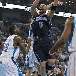 05 April 2009: Utah Jazz forward Carlos Boozer (5) shoots over New Orleans Hornets guard Rasual Butler (45) during a NBA game between the New Orleans Hornets and the Utah Jazz at the New Orleans Arena in New Orleans, Louisiana.