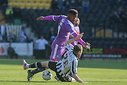 Notts County defender Gill Swerts tackles Plymouth Argyle forward Reuben Reid  during the Sky Bet League 2 match between Notts County and Plymouth Argyle at Meadow Lane, Nottingham, England on 11 October 2015. Photo by Simon Davies.