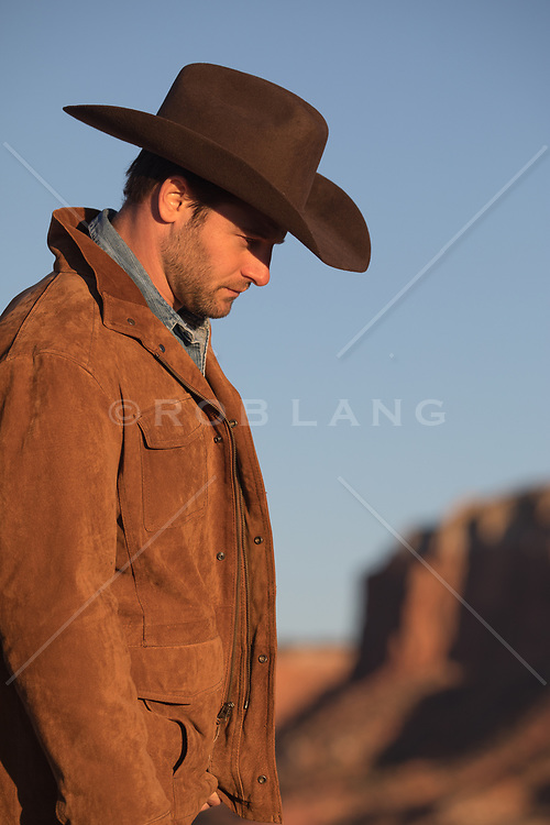 portrait of a handsome cowboy at sunset