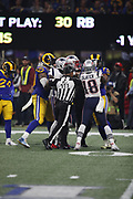 NFL back judge Terrence Miles (111) breaks up a scuffle during the NFL Super Bowl 53 football game featuring the New England Patriots against the Los Angeles Rams on Sunday, Feb. 3, 2019, in Atlanta. The Patriots defeated the Rams 13-3. (©Paul Anthony Spinelli)