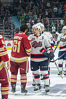 REGINA, SK - MAY 27: Sam Steel #23 of Regina Pats leads the team in handshakes with Acadie-Bathurst Titan at the Brandt Centre on May 27, 2018 in Regina, Canada. (Photo by Marissa Baecker/CHL Images)