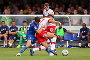 AFC Wimbledon midfielder Callum Reilly (33) battles for possession with Rotherham United midfielder Matt Crooks (17) during the EFL Sky Bet League 1 match between AFC Wimbledon and Rotherham United at the Cherry Red Records Stadium, Kingston, England on 3 August 2019.