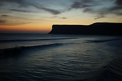 © Licensed to London News Pictures. <br /> 08/10/2014. <br /> <br /> Saltburn, United Kingdom<br /> <br /> Waves break as the sun starts to rise over Huntcliff in Saltburn by the Sea in Cleveland.<br /> <br /> Photo credit : Ian Forsyth/LNP
