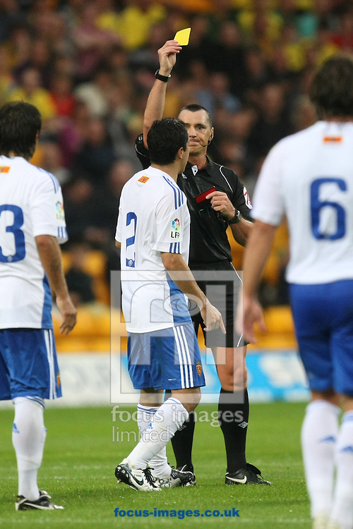 Referee N Swarbrick books Efrain Juarez of Real Zaragoza during a pre season friendly at Carrow Road stadium, Norwich...Picture by Paul Chesterton/Focus Images Ltd.  07904 640267.3/8/11