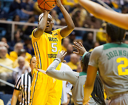 Jan 30, 2016; Morgantown, WV, USA; West Virginia Mountaineers guard Tynice Martin (5) shoots a three pointer during the third quarter against the Baylor Bears at WVU Coliseum. Mandatory Credit: Ben Queen-USA TODAY Sports