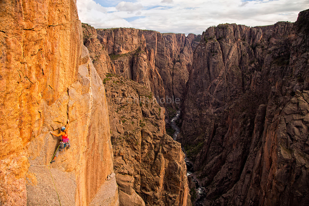 """Kate Rutherford climbing the """"Free Nose,"""" 12c, North Rim, Black Canyon of the Gunnison."""