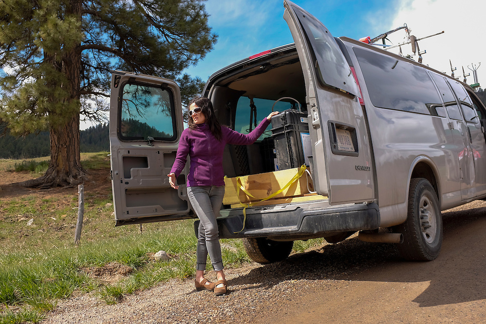 Eryka Thorley, a climate scientist working in NOAA's Earth System Research Laboratory, Boulder, Colorado, takes a moment to explain how air quality samples are made in the field using the NOAA mobile Laboratory.