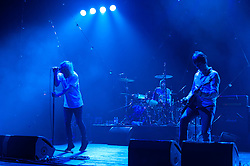"""© Licensed to London News Pictures. 08/06/2012. London, UK. The Charlatans perform live at Hammersmith Apollo, playing their 1997 and fifth studio album """"Telling' Stories"""" in its entirety.  In this picture L to R - Tim Burgess, Jon Brookes, Mark Collins.  Photo credit : Richard Isaac/LNP"""