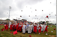 Students toss their caps at the end of the Northridge High School 79th annual commencement at the Northridge High School Stadium in Dayton, Friday, June 1, 2012.