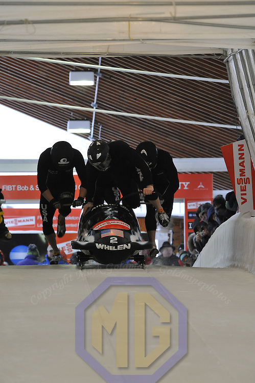 16 December 2007:  The USA 1 four-man bobsled driven by Steve Holcomb with Pavle Jovanovic, Steve Mesler and brakeman Brock Kreitzburg compete at the FIBT World Cup 4-Man bobsled competition on December 16, 2007 at the Olympic Sports Complex in Lake Placid, NY.  The USA 1 team finished in 2nd place as the Russia 2 sled driven by Alexandr Zubkov won the race with a time of 1:48.79.