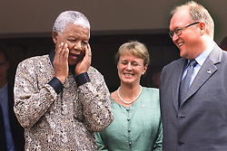 NELSON ROLIHLAHLA MANDELA (July 18, 1918 - December 5, 2013) world renowned civil rights activist and world leader dies at 95. Mandela emerged from prison to become the first black President of South Africa in 1994. As a symbol of peacemaking, he won the 1993 Nobel Peace Prize. Joined his countries anti-apartheid movement in his 20s and then the ANC (African National Congress) in 1942. For next 20 years, he directed a campaign of peaceful, non-violent defiance against the South African government and its racist policies and for his efforts was incarcerated for 27 years. PICTURED: Swedish Prime Minister GORAN PERSSON, and his wife ANNIKA PERSSON, with South African President NELSON MANDELA.