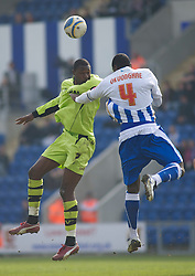COLCHESTER, ENGLAND - Saturday, April 24, 2010: Tranmere Rovers' Bas Savage and Colchester United's Magnus Okuonghae in action during the Football League One match at the Western Community Stadium. (Photo by Gareth Davies/Propaganda)