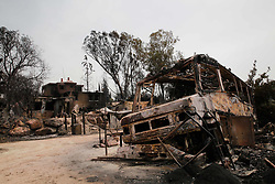 May 24, 2019: Mevo Modi'In, Israel: A burnt-down vehicle following a fire amidst extreme heat wave in the village of Mevo Modi'im, Israel. The Israeli government said it is asking for international aid to fight dozens of huge fires that broke out on Thursday because of extreme hot weather of more than 40 degrees Celsius. (Credit Image: © Gil Cohen Magen/Xinhua via ZUMA Wire)