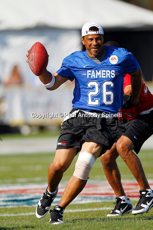 Former Pittsburgh Steelers defensive back Rod Woodson (26) of the Famers team runs the ball while playing flag football in the EA Sports Madden NFL 11 Launch celebrity and NFL player flag football game held at Malibu Bluffs State Park on July 22, 2010 in Malibu, California. (©Paul Anthony Spinelli)