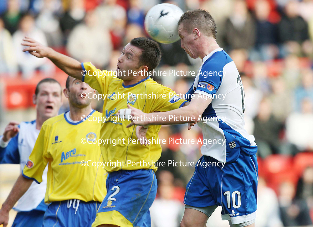 St Johnstone v Queen of the South....20.10.07<br /> Andy Jackson gets ahead of Eric Paton to head home saints second goal<br /> Picture by Graeme Hart.<br /> Copyright Perthshire Picture Agency<br /> Tel: 01738 623350  Mobile: 07990 594431