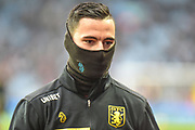 Aston Villa defender Ahmed Elmohamady (27) wrapped up against the cold during the EFL Sky Bet Championship match between Aston Villa and Hull City at Villa Park, Birmingham, England on 19 January 2019.