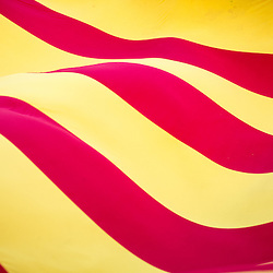A giant Catalan flag is displayed during a rally in support of a republic in Spain.