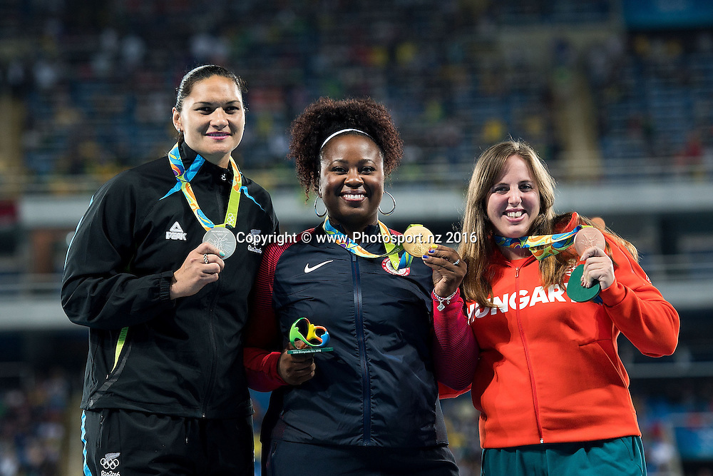 New Zealand's Valerie Adams (L) Silver, Michelle Carter of the USA Gold (C and Anita Marton Hungry Bronze during a medal ceremony for the Women's Shot Put in Olympic Stadium at the 2016 Rio Olympics on Saturday the 13th of August 2016. © Copyright Photo by Marty Melville / www.Photosport.nz