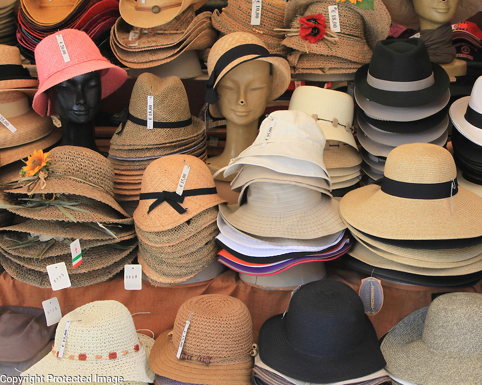 Hats in a Venetian marketplace photographed using only existing light
