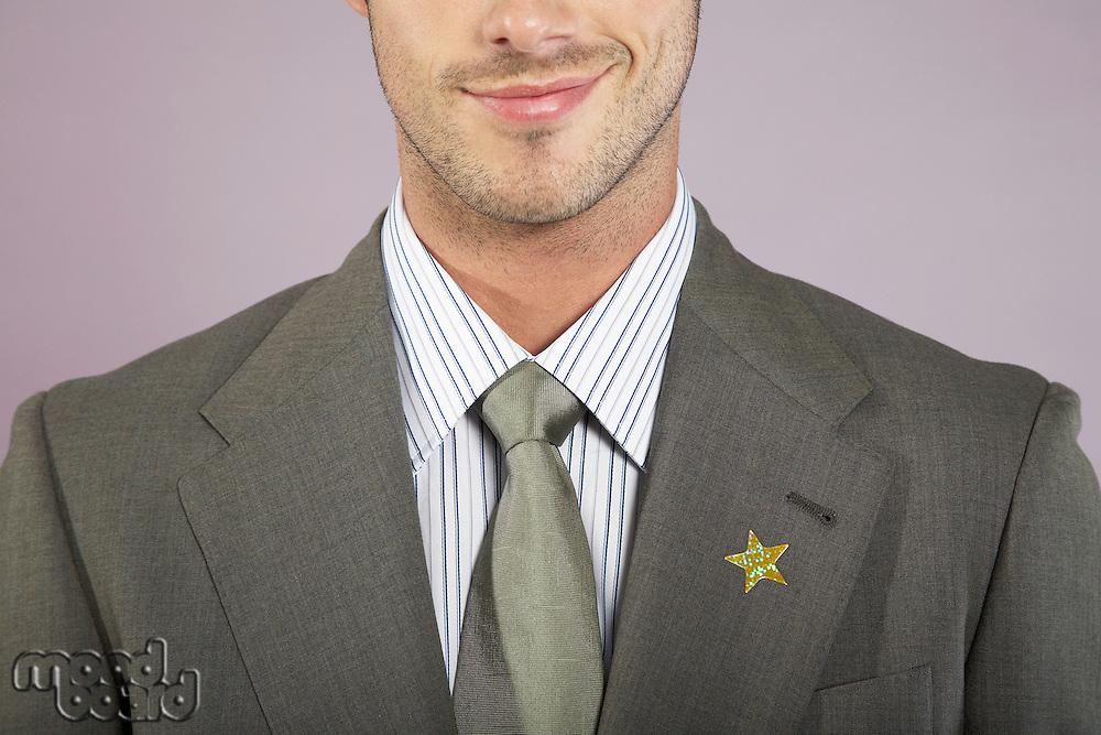 Businessman with gold star on suit portrait