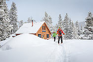 Heather Hudson and Craig Muderlak of Boulder, Colorado, head out on a day of backcountry skiing during their multi-night stay at the McNamara Hut in Colorado.