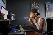 ATLANTA GA. August 14, 2014. Sonny Digital (Sonny Corey Uwaezuoke) creating music in his apartment/studio/office in Atlanta, GA. Photo by Michael A. Schwarz