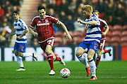 Middlesbrough midfielder Stewart Downing (19)  and Reading defender Paul McShane (5)  during the Sky Bet Championship match between Middlesbrough and Reading at the Riverside Stadium, Middlesbrough, England on 12 April 2016. Photo by Simon Davies.