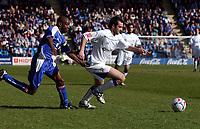 Photo: Olly Greenwood.<br />Gillingham v Huddersfield Town. Coca Cola League 1. 08/04/2006. Huddersfield's Pawel Abbott is held back by Gillingham's Ian Cox.