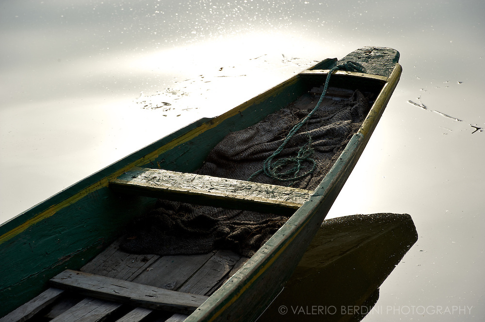 A fisherman boat at sunset. Dal Lake. Kashmir. India
