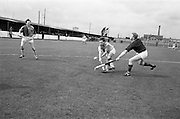 11/04/1964<br /> 04/11/1964<br /> 11 April 1964<br /> Irish Senior Hockey Cup Final, Three Rock Rovers v Church of Ireland (Cork) at Londonbridge Road, Dublin. Alec Findlater (left), Three Rock Rovers, and a Church of Ireland back tussle for the ball during the game.