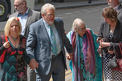 London, June 6th 2014. Entertainer and artist Rolf Harris arrives at Court with his daughter Bindi, left, his wife Alwen and niece Jenny, right,  as his trial on 12 counts of indecent assault against 4 girls aged 7 to 19 continues.