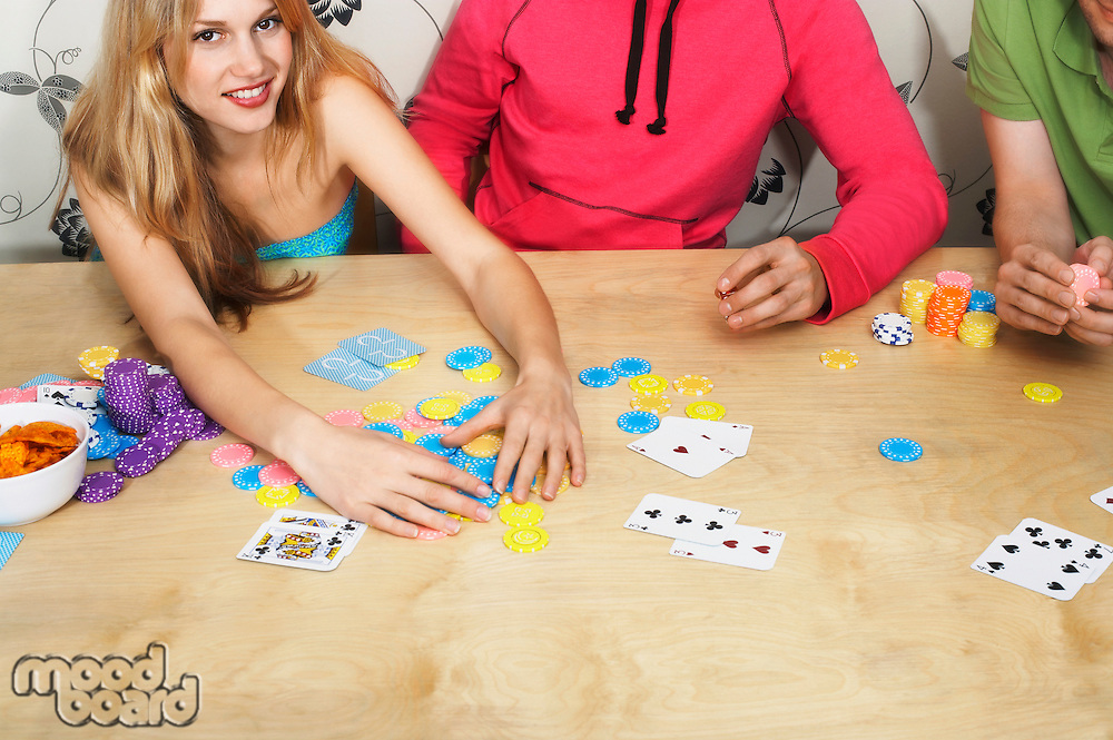 Friends Playing Cards woman grabbing chips