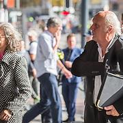 NLD/Amsterdam/20171014 - Besloten erdenkingsdienst overleden burgemeester Eberhard van der Laan, Herman van Veen en partner Gaëtane Bouchez