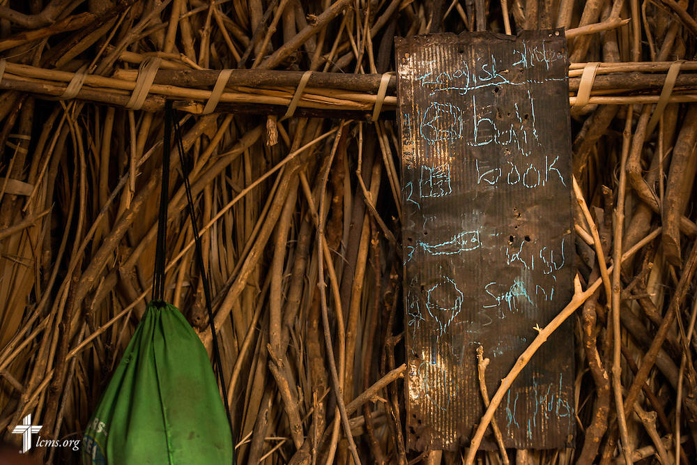 A piece of corrugated metal serves as an English instruction tool in a home of a small village on Friday, Oct. 16, 2015, in the Turkana region of northwest Kenya. LCMS Communications/Erik M. Lunsford