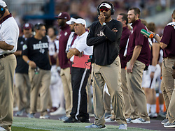 Texas A&M head coach Kevin Sumlin watches a replay during the first quarter of an NCAA college football game against South Carolina Saturday, Sept. 30, 2017, in College Station, Texas. (AP Photo/Sam Craft)