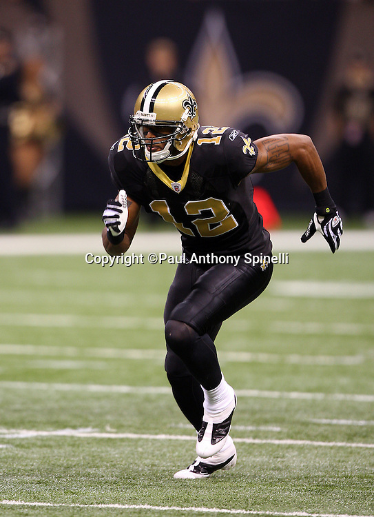 NEW ORLEANS - DECEMBER 07: Wide receiver Marques Colston #12 of the New Orleans Saints goes out for a pass during the game against the Atlanta Falcons at the Louisiana Superdome on December 7, 2008 in New Orleans, Louisiana. The Saints defeated the Falcons 29-25. ©Paul Anthony Spinelli *** Local Caption *** Marques Colston