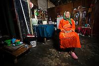 Ibu Nuria, Jongaya leprosy settlement, Makassar, Sulawesi, Indonesia. Ibu Nuria was born in Sumbawa, Nusa Tenggara Timor, in 1933.  She lived through WWII and was in Class 3 when the Japanese invaded.  She contracted leprosy in 1962 and after losing her foot, she moved to Jongaya in Makassar.  She now lives in a shelter for older people at the settlement.  Ibu Nuria volunteers for Permata and helps out at the weekly self-help group.