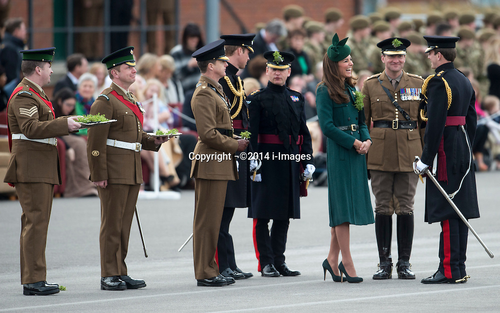 The Duke and Duchess of Cambridge present traditional sprigs of shamrocks to mark St Patrick's day to Officers and Guardsman of the 1st Battalion Irish Guards at Mons Barracks, Aldershot, United Kingdom. Monday, 17th March 2014.  Picture by i-Images