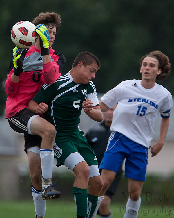 West Deptford's Joey Pinto collides with Sterling goalkeeper Colin Pierce as Pierce tries to make a saveduring the first match of the season at Sterling High School on Thursday September 8, 2011.