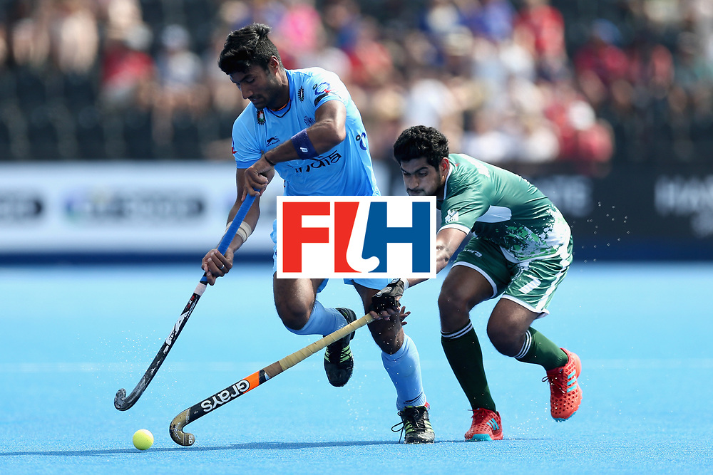 LONDON, ENGLAND - JUNE 18: Surender Kumar of India tangles with Muhammad Arslan Qadir of Pakistan during the Hero Hockey World League Semi Final match between Pakistan and India at Lee Valley Hockey and Tennis Centre on June 18, 2017 in London, England.  (Photo by Alex Morton/Getty Images)