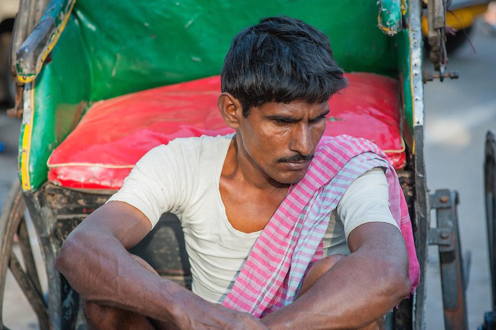 Rickshaw puller waiting for customers in Kolkata (India)