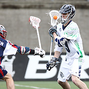 Matt Abbott #3 of the Chesapeake Bayhawks keeps the ball from Kevin Buchanan #27 of the Boston Cannons during the game at Harvard Stadium on April 27, 2014 in Boston, Massachusetts. (Photo by Elan Kawesch)