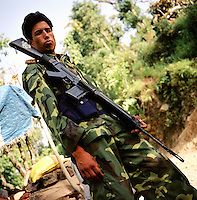 A Maoist rebel of the PLA, or People?s Liberation Army, with his gun in a remote part of western Nepal controlled by the Maoist rebels. (Photo/Scott Dalton)